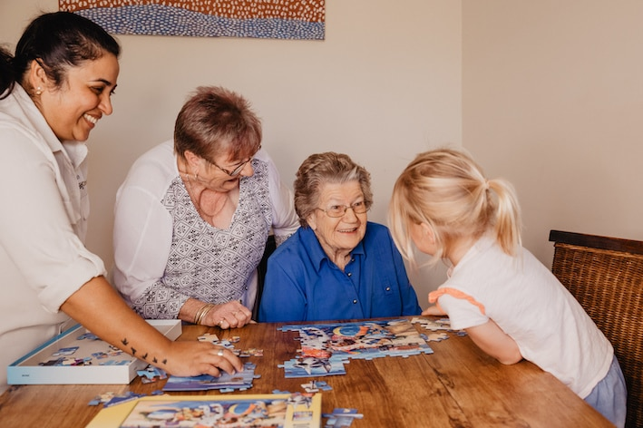 CraigCare-Residential-Aged-Care-Home-Family-residents-and-family-playing-games